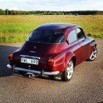 A Fire Red Flake Saab from SWEDEN.