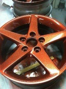 Orange copper metal flakes on a wheel