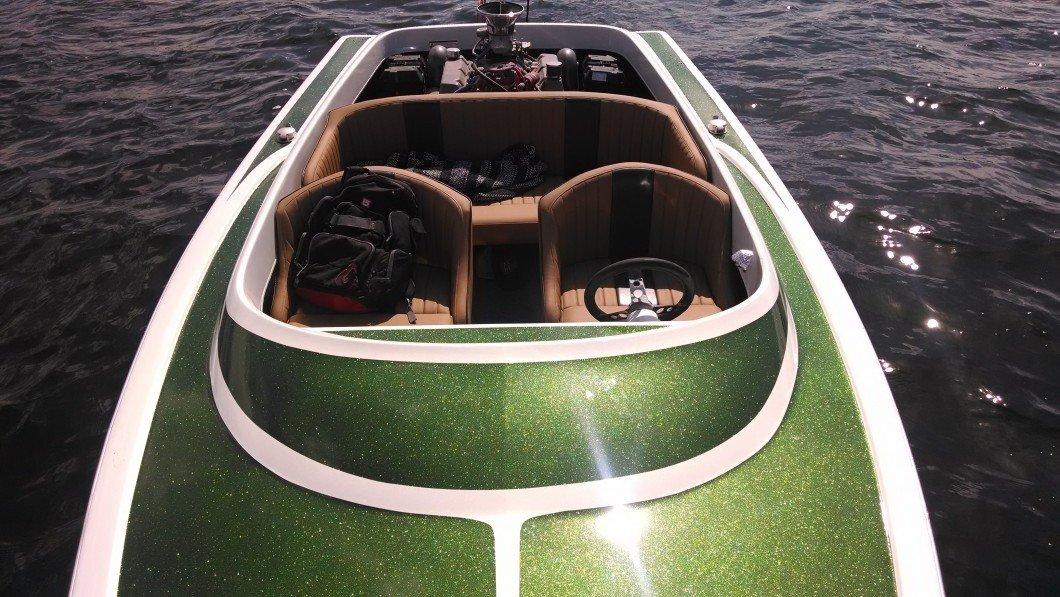 Moss-Green_flake_boat-in-the-sun