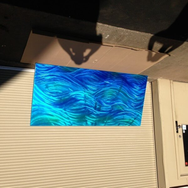 metal art with blue ghost pealrl