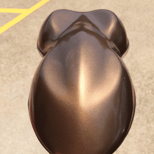 Nut Brown candy paint pearls sprayed on a speed shape, or car shape test panel.