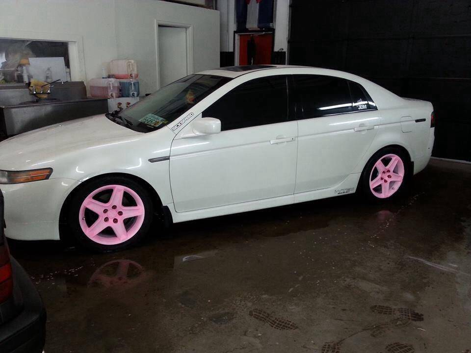 Car With The Pink To Orange Glow In Dark Wheels Light